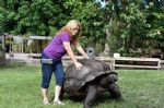 Laura-standing-next-to-and-Lumpy-large-Male-Aldabra-Tortoise.jpg