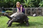 Laura-and-Bernie-standing-next-to-Galapagoes.jpg